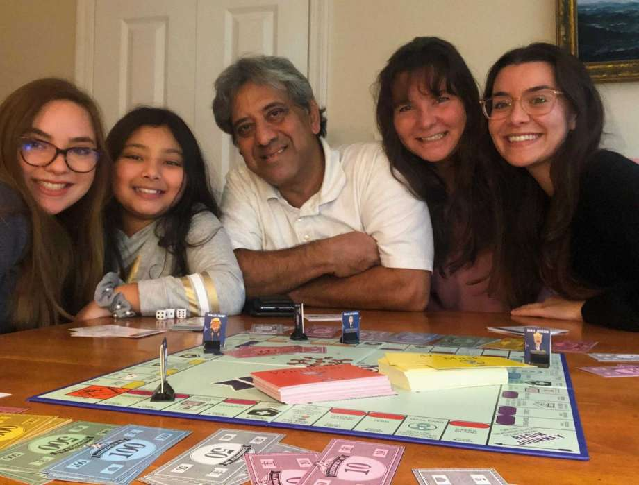 Family with Covidopoly19 game